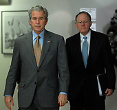 United States President George W. Bush arrives to speak to the media after visiting the Office of the Director of National Intelligence and the National Counterterrorism Center (NCTC) in McLean, Virginia, on December 8, 2008. With Bush is Director of National Intelligence Mike McConnell (R).<br /> Credit: Roger L. Wollenberg / Pool via CNP