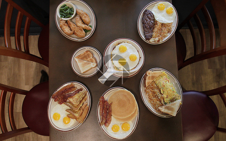 The South Main Diner in Caseyville features a wide selection of entrees for breakfast, lunch and supper on its menu. Clockwise, from top left: Chicken tenders and green beans; steak and eggs, with hash browns; Western omelet with toast; hotcakes with bacon and eggs; French toast with bacon and eggs; and in the center, the Breakfast Skillet with toast.