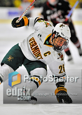 27 January 2012: University of Vermont Catamount forward Brett Leonard, a Senior from South Burlington, VT, regains his balance during a game against the Northeastern University Huskies at Gutterson Fieldhouse in Burlington, Vermont. The Catamounts fell to the Huskies 8-3 in the first game of their 2-game Hockey East weekend series. Mandatory Credit: Ed Wolfstein Photo