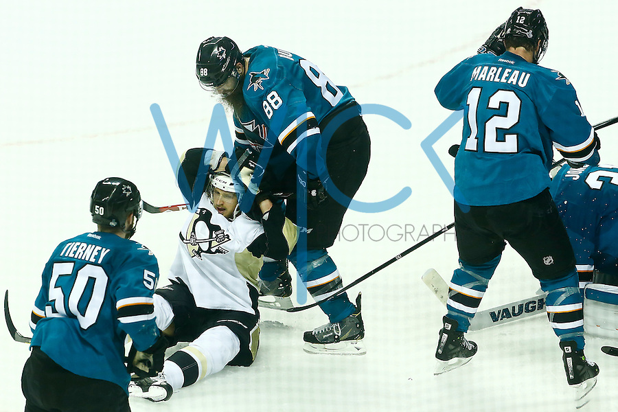Carl Hagelin #62 of the Pittsburgh Penguins is hit by Brent Burns #88 of the San Jose Sharks during game three of the Stanley Cup Final at the SAP Center in San Jose, California on June 4, 2016. (Photo by Jared Wickerham / DKPS)