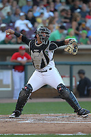 Dayton Dragons catcher Yovan Gonzalez #4 throws during a game against the Lake County Captains at Fifth Third Field on June 25, 2012 in Dayton, Ohio. Lake County defeated Dayton 8-3. (Brace Hemmelgarn/Four Seam Images)