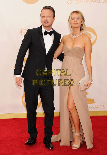 Aaron Paul, Lauren Parsekian<br /> The 65th Annual Primetime Emmy Awards - Arrivals held at The Nokia Theatre L.A. Live in Los Angeles, California, USA.<br /> September 22nd, 2013<br /> full length bow tie black tuxedo white shirt brown beige strapless dress married husband wife     <br /> CAP/ROT/TM<br /> &copy;Tony Michaels/Roth Stock/Capital Pictures