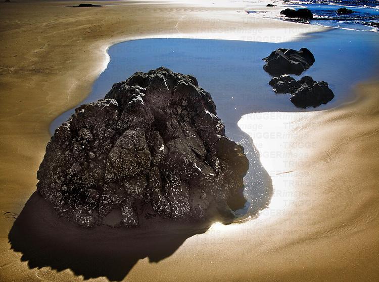 Small rocks in a sndy beach