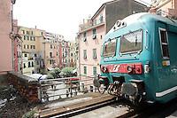 Un treno in transito alla stazione di Vernazza, uno dei borghi delle Cinque Terre.<br /> A train passes through the station of Vernazza at the Cinque Terre.<br /> UPDATE IMAGES PRESS/Riccardo De Luca