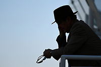A racegoers makes a call during Afternoon Racing at Salisbury Racecourse on 3rd October 2018