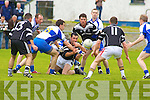 SWARM DEFENCE: Ardfert midfielder.John Dowling tries to get this pass.through to colleague Brendan Flaherty.as Castleisland's defenders, led by captain.John Brennan, surround him..CASTLEISLAND DESMONDS 1-14.ARDFERT 1-12 DESMONDS turned on the style in the third quarter and in the process.overturned a five point deficit to go two points in front. This paved the.way for an important victory in this vital Division One relegation battle.at Castleisland on Sunday.