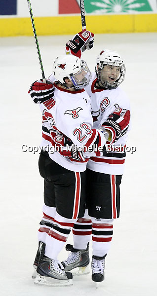 UNO's Eric Olimb (No. 23) and Joey Martin celebrate Olimb's goal during the third period. UNO defeated Michigan Tech 5-2 Thursday night at Qwest Center Omaha. (Photo by Michelle Bishop)
