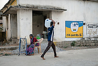 Local residents fill up their pitchers of water with municipal water in Ambedkar Nagar in Medak, Telangana, India.