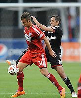 Washington D.C. - April 26, 2014: FC Dallas Mitchel (31) shields the ball against Davy Arnaud (8) of D.C. United. D.C. United defeated the FC Dallas 4-1 during a Major League Soccer match for the 2014 season at RFK Stadium.
