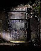Fine art night photography.  Photograph of the door which leads to the chambers and rooms within Mortar Battery Sandy Hook, New Jersey.  Limited edition Fine Art Print printed to conservation standards