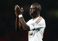 Madou Barrow of Swansea City thanks the fans at the end of the game during the Barclays Premier League match between Manchester United and Swansea City played at Old Trafford, Manchester on January 2nd 2016
