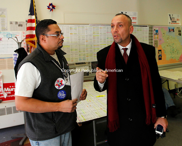 """Waterbury, CT-06 November 2012-110612CM01-  Victor Cuevas, right, Democratic candidate for the 75th District talks with campaign manager, Geraldo C. Reyes, at Cuevas headquarters Tuesday afternoon in Waterbury.  Cuevas is running against Republican John """"Jack"""" Alseph Jr.     Christopher Massa Republican-American"""