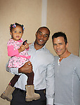 "General Hospital's Scott Reeves ""Dr. Steven Lars Webber"" is the Celebrity Grand Marshal and Sports Celebrity Virginia Tech, NFL, WFL wide receiver Shawn Scales with daughter Morgan at the 33rd Annual Mountain State Apple Harvest Festival (MSAHF) 2012 on October 20, 2012 at the Queen's Grand Ball at the Historic Shenandoah Hotel in Martinsburg, West Virginia. (Photo by Sue Coflin/Max Photos)"