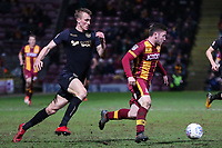 Dan Burn of WigaN chases Shay McCartan of Bradford City during the Sky Bet League 1 match between Bradford City and Wigan Athletic at the Northern Commercial Stadium, Bradford, England on 14 March 2018. Photo by Thomas Gadd.