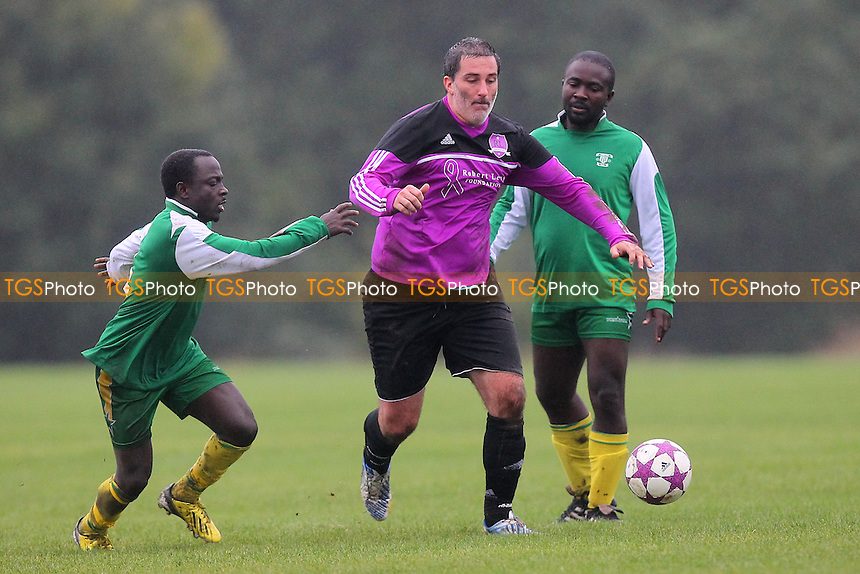 Black Meteors (green) vs RL United - Hackney & Leyton Sunday League Football at South Marsh, Hackney Marshes, London - 13/10/13 - MANDATORY CREDIT: Gavin Ellis/TGSPHOTO - Self billing applies where appropriate - 0845 094 6026 - contact@tgsphoto.co.uk - NO UNPAID USE