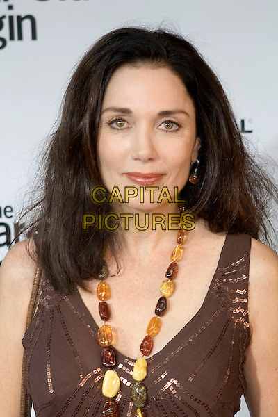 """STEPHANIE KRAMER.""""The 40 Year-Old Virgin"""" Premiere,.held at The Arclight Cinema,.Los Angeles, 11th August 2005.portrsit headshot brown v-neck gold sequin top amber bead necklace earring.www.capitalpictures.com.sales@capitalpictures.com.© Capital Pictures."""
