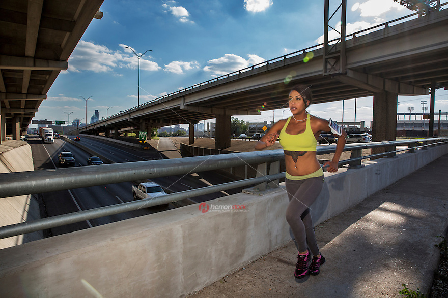 Downtown Austin, Texas is a mecca for urban runners, walkers and cyclists. Endurance athletes train on bridges over I-35 in downtown Austin, Texas.