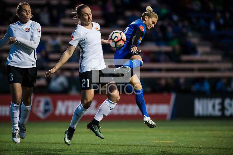 Seattle, WA - April 15th, 2017: Leah Galton and Jess Fishlock during a regular season National Women's Soccer League (NWSL) match between the Seattle Reign FC and Sky Blue FC at Memorial Stadium.