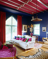 Indigo, cherry red and turquoise are just some of the colours juxtaposed in this confidently vibrant living room