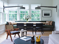 The informal, family room has an oak-and-nickel table by KGBL is flanked by a custom sofa in a Holly Hunt leather and 1930s Alvar Aalto chairs; the vintage wall lights are by Stilnovo, the photograph is by Hiroshi Sugimoto, and the walls are painted in Donald Kaufman Color's Collection No. 51.