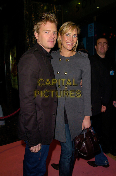 "JAMES MIDGLEY & JENNI FALCONER.Attending ""A Night With Nick"" Gala Charity Event at Soho Revue Bar, London, England, November 26th 2007..half length grey coat .CAP/CAN.©Can Nguyen/Capital Pictures"
