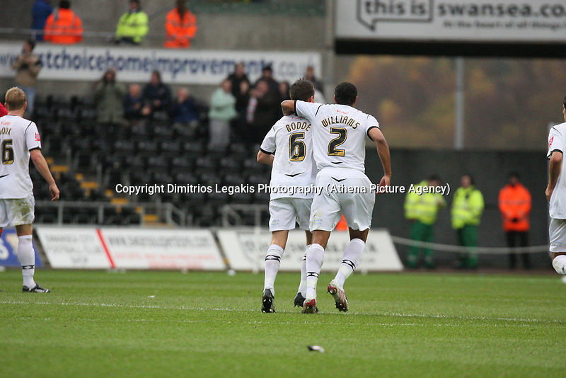 Pictured: Ferrie Bodde (left) and Ashley Williams (right) of Swansea City<br />