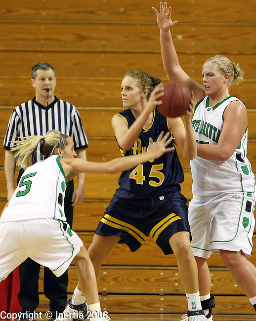 Vermillion, SD - March 8: Karla Beck #5 and Ashley Langen #55 of North Dakota double team Dani Arends #45 of Augustana in the first half of their North Central Conference semi-final game Saturday afternoon at the DakotaDome in Vermillion. (Photo by Dave Eggen/Inertia)