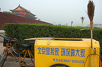 Tricycle collecting rubbish with the Temple of Heavenly Peace in the background, Tiananmen Square, Beijing, China.