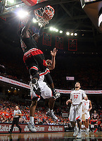 Louisville forward Montrezl Harrell (24) dunks the ball in front of Virginia players during the second half of an NCAA basketball game Saturday Feb. 7, 2015, in Charlottesville, Va. Virginia defeated Louisville  52-47. (Photo/Andrew Shurtleff)