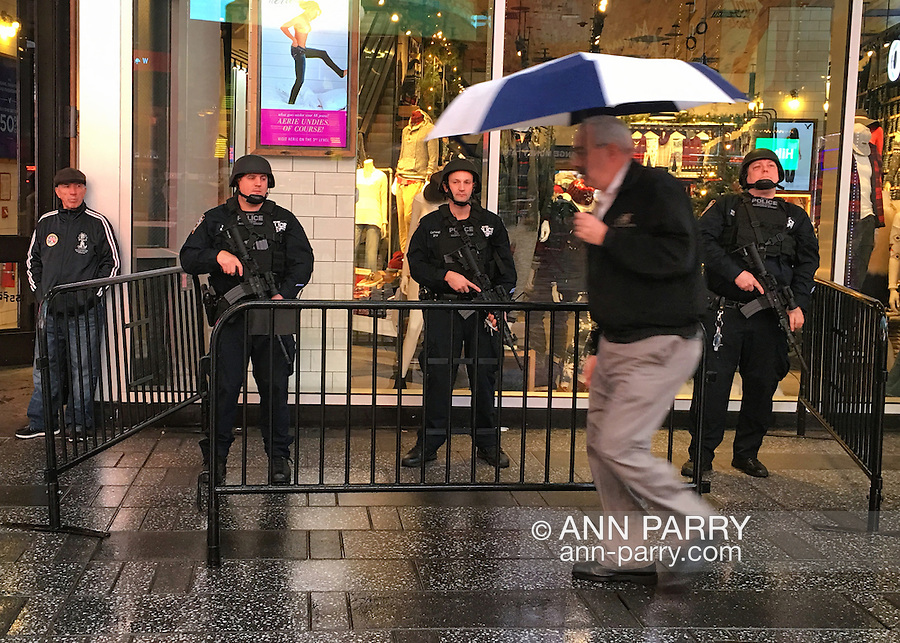 NYC, NY, USA. 19th Nov. 2015. Strategic Response Group members are seen in midtown Manhattan, including in the heart of Times Square, the day after an ISIS propaganda video came out threatening New York City, particularly Times Square. NYC's Mayor and Police Commissioner both said there is no specific and credible threat against New York City.