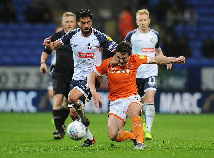 Blackpool's Matty Virtue under pressure from Bolton Wanderers' Jason Lowe<br /> <br /> Photographer Kevin Barnes/CameraSport<br /> <br /> The EFL Sky Bet League One - Bolton Wanderers v Blackpool - Monday 7th October 2019 - University of Bolton Stadium - Bolton<br /> <br /> World Copyright © 2019 CameraSport. All rights reserved. 43 Linden Ave. Countesthorpe. Leicester. England. LE8 5PG - Tel: +44 (0) 116 277 4147 - admin@camerasport.com - www.camerasport.com