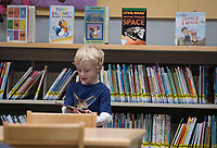 NWA Democrat-Gazette/J.T. WAMPLER Grant Millett, 4, looks through books Monday Nov. 5, 2018 at the Springdale Public Library. Today ((TUESDAY)) the library hosts Rattle & Rhyme Toddler Time and Wigglers & Jigglers Pre-school Story Time, both at 9:30 A.M. For more information about activities at the Springdale Public Library visit www.springdalelibrary.org. Grant was at there library with his mother Lea Millett of Fayetteville.