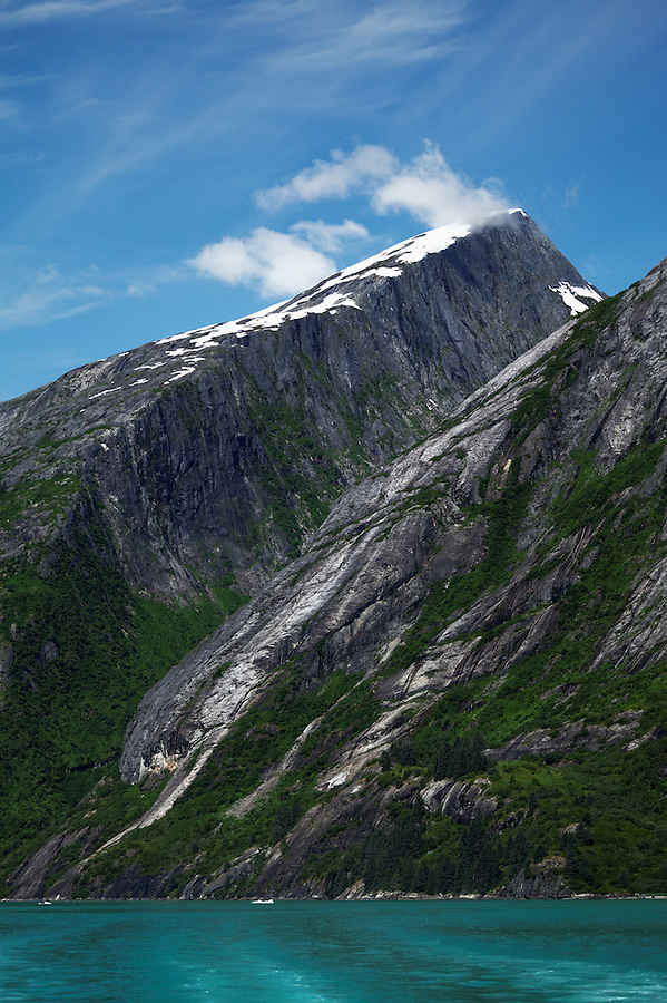 Sheer-walled mountains and hanging valley rise above Tracy Arm, Southeast Alaska, USA