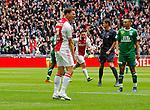 Nederland, Amsterdam, 15 april 2012.Eredivisie .Seizoen 2011-2012.Ajax-De Graafschap.Derk Boerrigter (l.) van Ajax juicht nadat hij de 1-0 heeft gescoord. Rechts Soufian Hassnaoui van De Graafschap