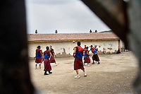 Young Tibetan Buddhist monks play basketball outside the Labrang Monastery in Xiahe, Gansu, China. Xiahe, home of the Labrang Monastery, is an important site for Tibetan Buddhists.  The population of the town is divided between ethnic Tibetans, Muslims, and Han Chinese.