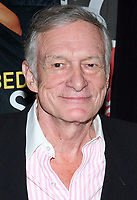 "27 September 2017 - Hugh Marston Hefner aka ""Hef"" was an American magazine publisher, editor, businessman, and international playboy best known as the editor-in-chief and publisher of Playboy magazine, which he founded in 1953. Hefner was the founder and chief creative officer of Playboy Enterprises, the publishing group that operates the magazine. Hefner was also a political activist and philanthropist. File Photo: 11 October 2005 - Virgin Megastore Times Square, NYC - Hugh Hefner signs copies of Nov. 2005 issue of Playboy Magazine. Photo Credit Jackson Lee/AdMedia"