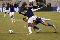 Colombian player Jackson Martinez (21) fights for the ball with Brazilian player Leandro Castan during their friendly match at MetLife Stadium in East Rutherford New Jersey, November 14, 2012. Photo by Eduardo Munoz Alvarez / VIEWpress.