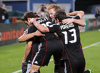 DC United teammates Chris Pontius and Dax McCarty celebrating Josh Wolff score in the 31th minute of the game.  DC United defeated The Seattle Sounders 2-1, at RFK Stadium, Wednesday  May 4, 2011.