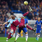 Olivier Giroud of Chelsea is challenged by Angelo Ogbonna of West Ham United during the Premier League match at Stamford Bridge, London. Picture date: 30th November 2019. Picture credit should read: Robin Parker/Sportimage