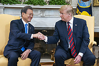 US President Donald J. Trump (R) welcomes Korean President Moon Jae-in (L) to the Oval Office of the White House in Washington, DC, USA, 11 April 2019. President Moon is expected to ask President Trump to reduce sanctions on North Korea in an attempt to jump start nuclear negotiations between North Korea and the US.<br /> CAP/MPI/RS<br /> ©RS/MPI/Capital Pictures