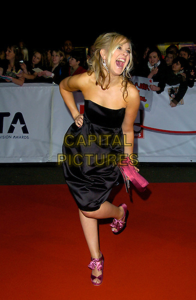 ZOE LISTER.The National Television Awards, Royal Albert Hall, London, England..October 31st, 2007.TV NTA full length strapless black dress purple pink clutch bag purse shoes ribbons mouth open hand on hip leg foot up gesture funny .CAP/CAN.© Can Nguyen/Capital Pictures