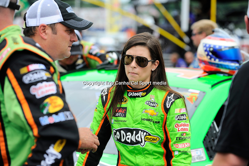 July 14, 2013 - Loudon, New Hampshire U.S. - Sprint Cup Series driver Danica Patrick (10) waits for the start of the NASCAR Sprint Cup Series Camping World RV Sales 301 held at the New Hampshire Motor Speedway in Loudon, New Hampshire, with her crew.   Eric Canha/CSM