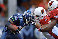 Sep 25, 2005; Seattle, WA, USA; Seattle Seahawks running back #20 Maurice Morris is face masked by Arizona Cardinals defensive tackle #91 Langston Moore in the fourth quarter at Qwest Field. Mandatory Credit: Photo By Mark J. Rebilas