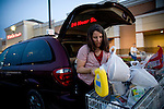 Sharon Ferrell loads groceries into her minivan in Roseville, CA May 13, 2009.