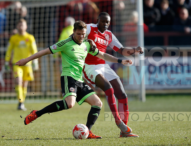 Dean Hammond of Sheffield Utd tussles with Shola Ameobi of Fleetwood Town  - English League One - Fleetwood Town vs Sheffield Utd - Highbury Stadium - Fleetwood - England - 5rd March 2016 - Picture Simon Bellis/Sportimage