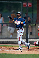 Atlanta Braves third baseman Jose Bautista (1) hits a long fly ball, that left fielder Adron Chambers (not shown) made a leaping catch at the wall for the out, in the top of the third inning during a Minor League Extended Spring Training game against the Philadelphia Phillies on April 20, 2018 at Carpenter Complex in Clearwater, Florida.  (Mike Janes/Four Seam Images)