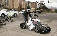 BOGOTA, COLOMBIA - JANUARY 17: Street performer Luis Rene Cruz, known as 'Colombian Transformer', works on a traffic light on January 18, 2019 in Bogota, Colombia.  Cruz lives with his wife and two children, he makes his life performing on traffic lights in Bogota since 2011 and makes an average of US$25 a day.   (Photo by Marcelo Villa/VIEWpress)