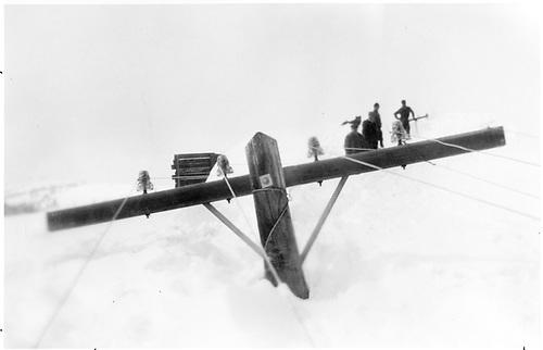 Workmen clearing telegraph lines from deep snow drift.<br /> D&amp;RGW  Cumbres Pass, CO