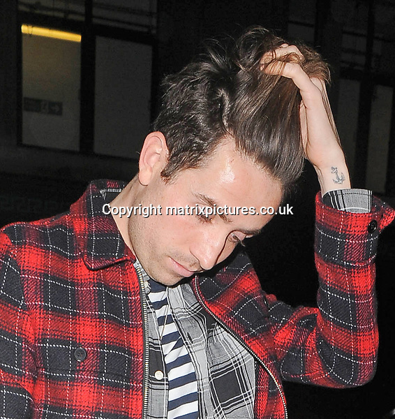NON EXCLUSIVE PICTURE: PALACE LEE / MATRIXPICTURES.CO.UK<br /> PLEASE CREDIT ALL USES<br /> <br /> WORLD RIGHTS<br /> <br /> British media presenter Nick Grimshaw is pictured as he arrives at the London Edition Hotel, for Alexa Chung's birthday party in London. <br /> <br /> NOVEMBER 9th 2013<br /> <br /> REF: LTN 137276