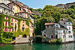 Looking up at the town of Pognana Lario with Roman bridges on Lake Como, Italy